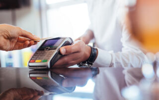 A customer uses a contactless credit card to make a payment
