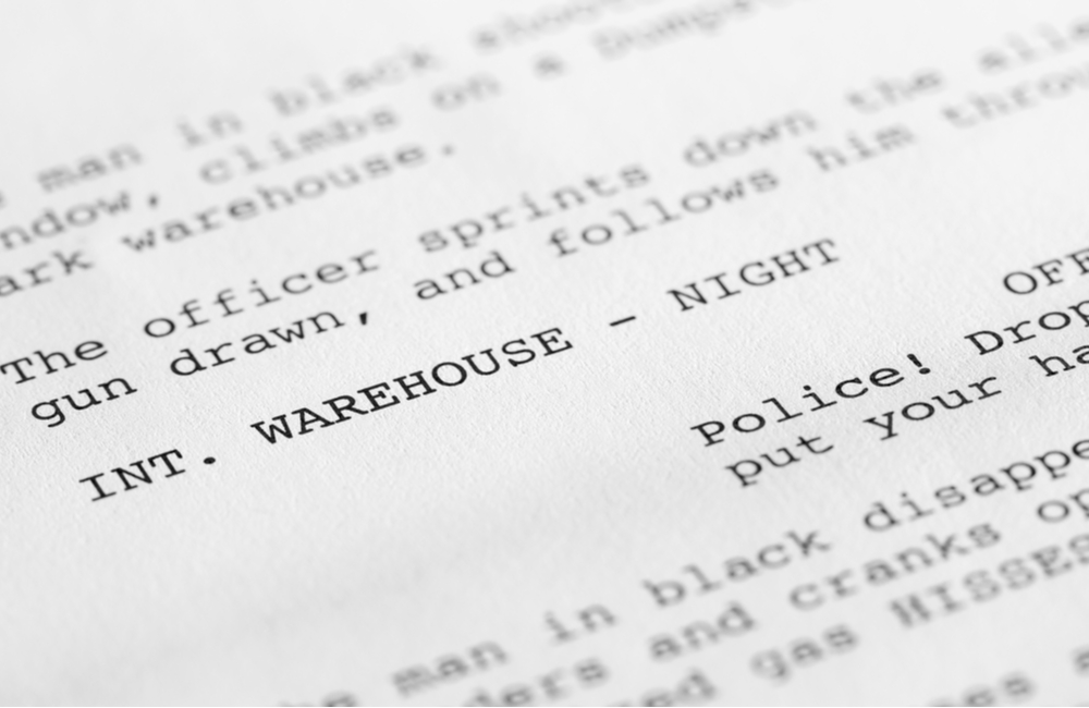 A close-up image of a properly formatted screenplay with generic text.