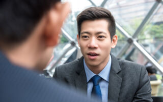 A businessman engages with a colleague using direct eye contact.
