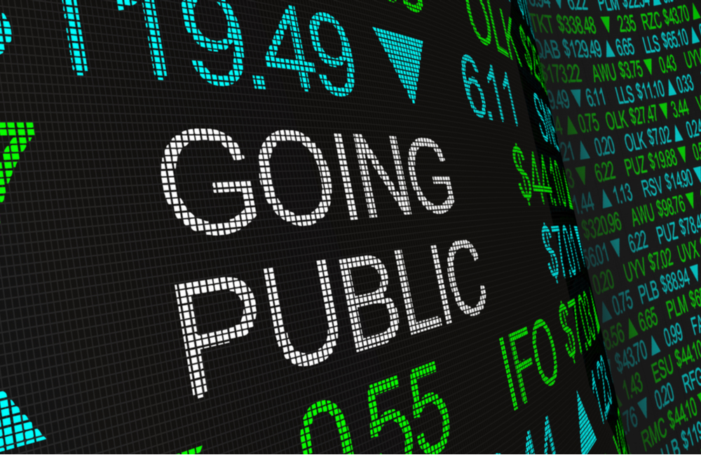 """A screen displaying the words """"going public"""""""